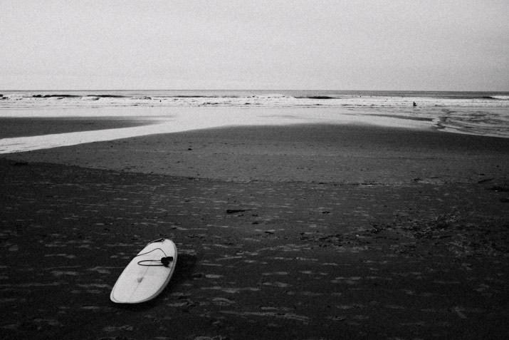 murdey surfboard short sand beach photo