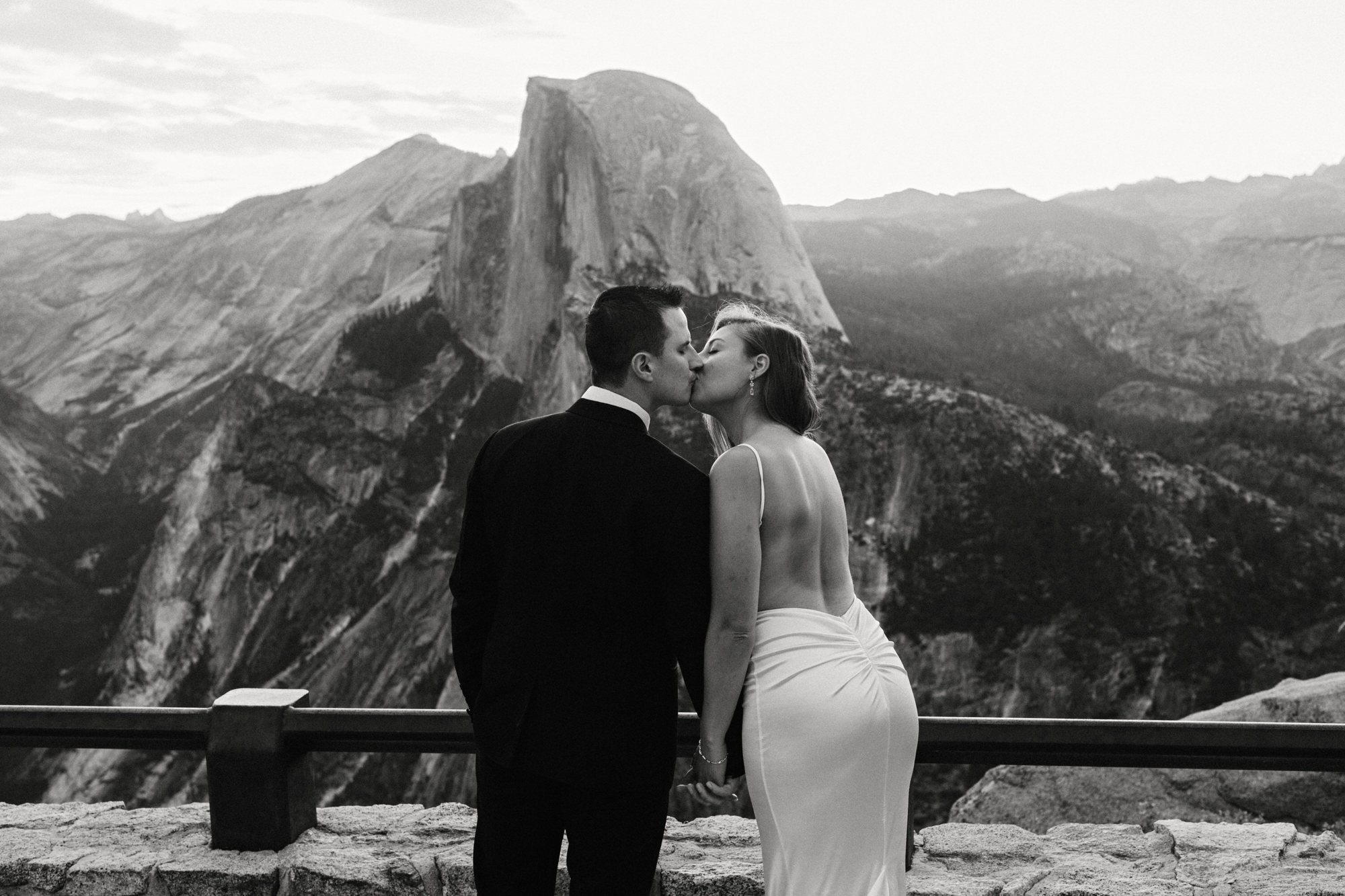 sunrise yosemite elopement kiss in black and white