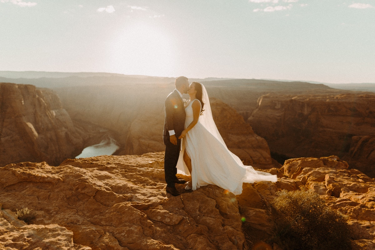 bride and groom kissing at horseshoe bend