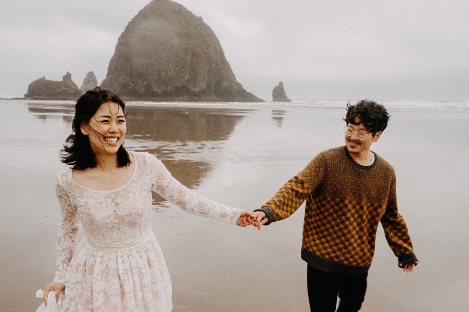 happy couple holding hands after oregon coast elopement