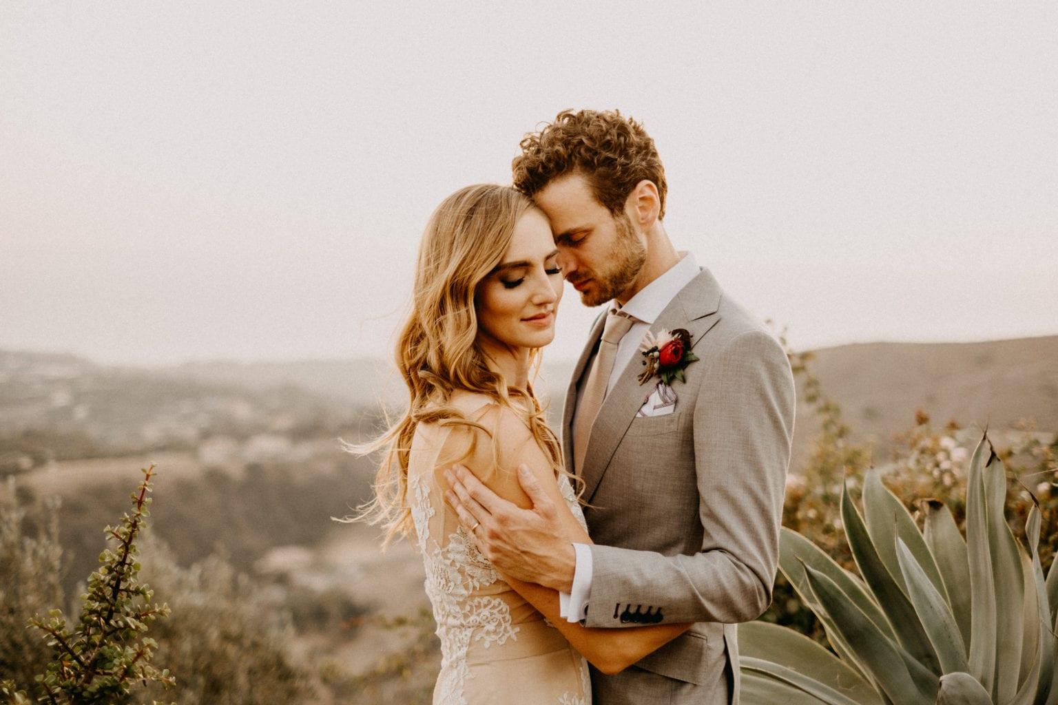 bride and groom at wedding in malibu california